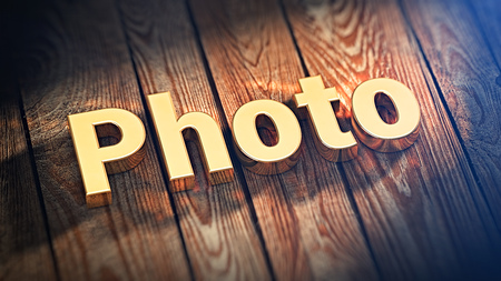 The word Photo is lined with gold letters on wooden planks. 3D illustration picture Stock Photo
