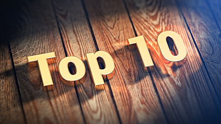 top 10: The word Top 10 is lined with gold letters on wooden planks. 3D illustration image