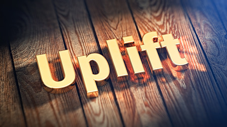 uplift: The word Uplift is lined with gold letters on wooden planks. 3D illustration pic Stock Photo