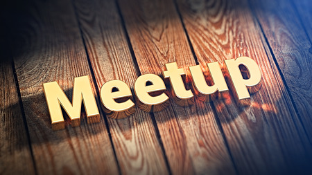 meetup: Welcome to our conferrence. The word Meetup is lined with gold letters on wooden planks. 3D illustration image