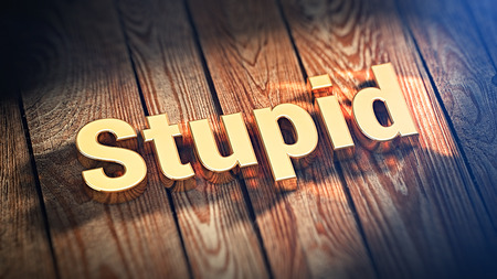 unintelligent: The word Stupid is lined with gold letters on wooden planks. 3D illustration pic