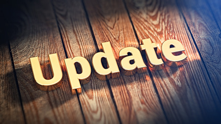 modernize: Update your software. The word Update is lined with gold letters on wooden planks. 3D illustration picture