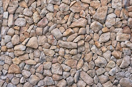 paredes de ladrillos: pequeñas piedras naturales ladrillo. piedras beige textura Foto de archivo