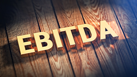 amortization: The acronym EBITDA is lined with gold letters on wooden planks. 3D illustration jpeg Stock Photo