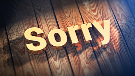 grieved: The word Sorry is lined with gold letters on wooden planks. 3D illustration picture