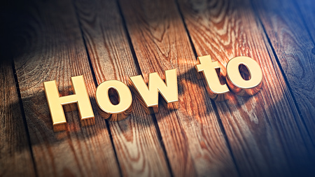 The word How To is lined with gold letters on wooden planks. 3D illustration picture