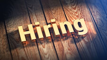 appoint: Now we are hiring! The word Hiring is lined with gold letters on wooden planks. 3D illustration picture