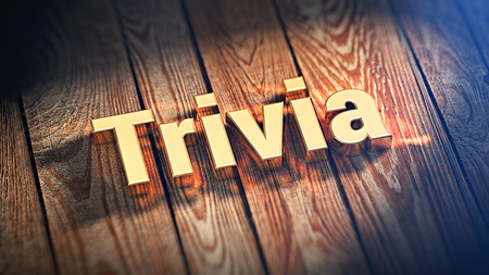 trivia: The word Trivia is lined with gold letters on wooden planks. 3D illustration image Stock Photo