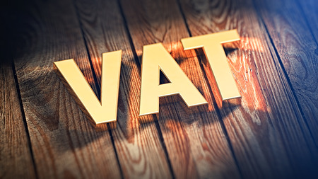 """Acronym """"VAT"""" is lined with gold letters on wooden planks. 3D illustration image"""