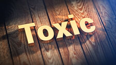 noxious: The word Toxic is lined with gold letters on wooden planks. 3D illustration jpeg
