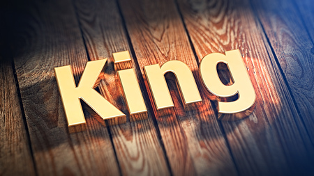 arbiter: The word King is lined with gold letters on wooden planks. 3D illustration image