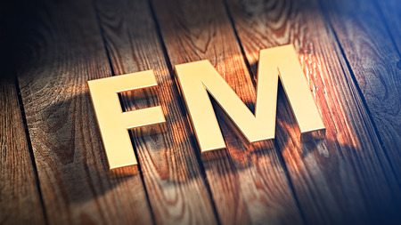 modulation: The word FM is lined with gold letters on wooden planks. 3D illustration image Stock Photo
