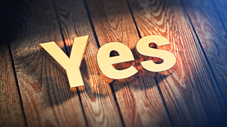 yup: The word Yes is lined with gold letters on wooden planks. 3D illustration image