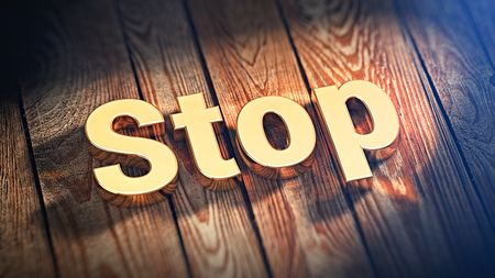 standstill: The word Stop is lined with gold letters on wooden planks. 3D illustration image