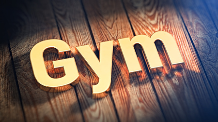 athletic type: The word Gym is lined with gold letters on wooden planks. 3D illustration image Stock Photo