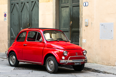 Florence, Italy - April 25, 2016. Red shiny bright Fiat 500L parked in the centre of Florence