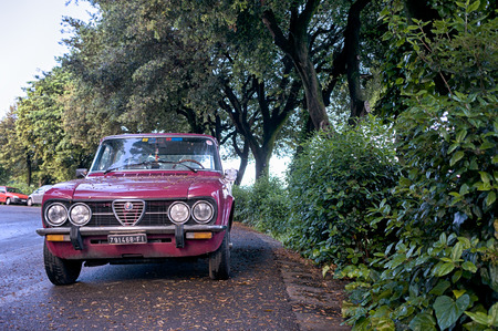 romeo: Florence, Italy - May 02, 2016. Retro Alfa Romeo car on the street of Florence. This model is Alfa Romeo Nuova Super 1300, manufactured in 1974-1977 years Editorial