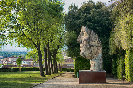 gigantic: Florence, Italy - April 20, 2016. Gigantic human face - the sculpture of modern art in Boboli Gardens, Florence, Italy Editorial