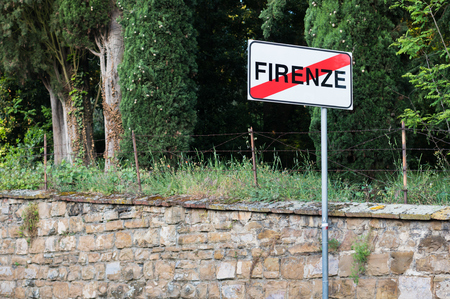 firenze: Road sign with crossed out word Firenze. The end of italian vacation to Florence.