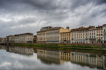 arno: Reflection of historical buildings on the embankment in the water of Arno river in Florence, Italy Stock Photo