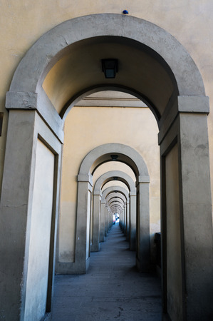 passageway: Arches of the Vasari Corridor in Florence, Italy. The Vasari Corridor is the famous passageway which connects the Palazzo Vecchio with the Palazzo Pitti.
