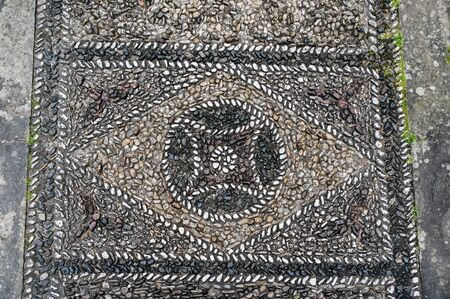 mosaic floor: Abstract geometric mosaic from pebble stones on the floor of Palazzo Medici Riccardi in Florence, Italy Stock Photo
