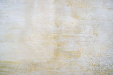 stucco: Slightly yellow aged stucco wall