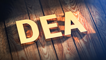 coordinating: The acronym DEA is lined with gold letters on wooden planks. 3D illustration image Stock Photo