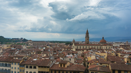 overpopulated: Red roofs of historic center of Florence in rainy day, Tuscany, Italy