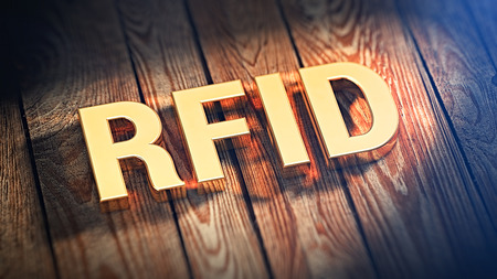 rfid: The acronym RFID is lined with gold letters on wooden planks. 3D illustration image Stock Photo