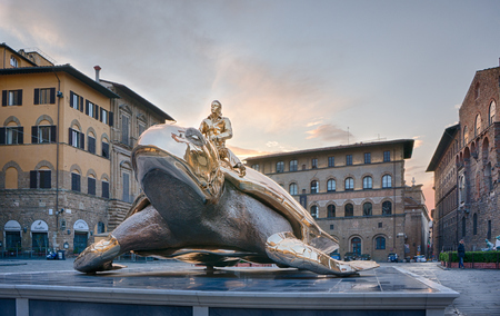 utopia: Florence, Italy - May 4, 2016:  sculpture Searching for Utopia by Jan Fabre on the Piazza della Signoria in Florence, Italy
