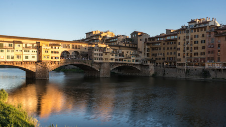 arno: The medieval stone arch bridge over the Arno river in Florence, Italy Stock Photo