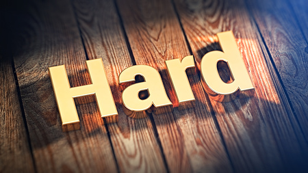hellish: The word Hard is lined with gold letters on wooden planks. 3D illustration image Stock Photo
