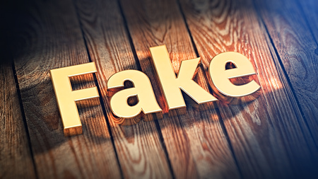 counterfeit: The word Fake is lined with gold letters on wooden planks. 3D illustration image