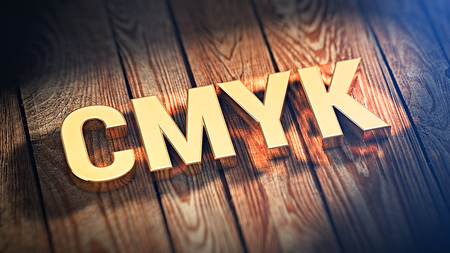 polygraphic: The Acronym CMYK is lined with gold letters on wooden planks. 3D illustration image Stock Photo
