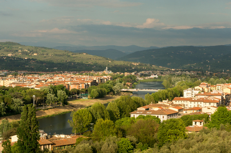 michelangelo: Red roofs of houses along the Arno river in Florence, Italy. View from piazzale Michelangelo.