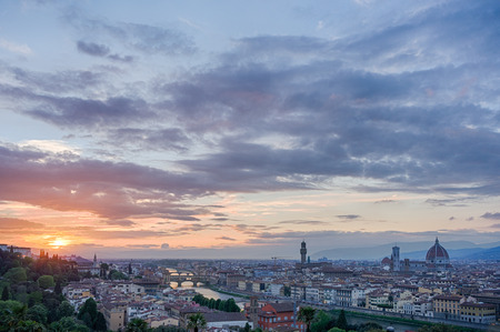 riverside landscape: Picturesque landscape of Florence at sunset with famous landmarks - the Cathedrale Santa Maria del Fiore, Ponte Vecchio and Palazzo Vecchio. View from piazzale Michelangelo on the opposite riverside of Arno river, Italy.