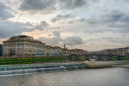 Old dam across the Arno river in Florence, Italy Stock Photo