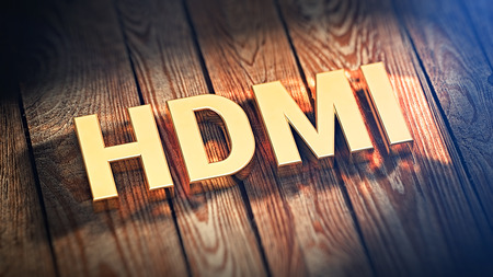 The acronym HDMI is lined with gold letters on wooden planks. 3D illustration image