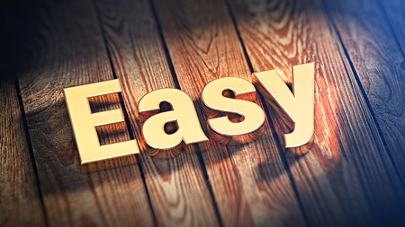 readily: The word Easy is lined with gold letters on wooden planks. 3D illustration image Stock Photo