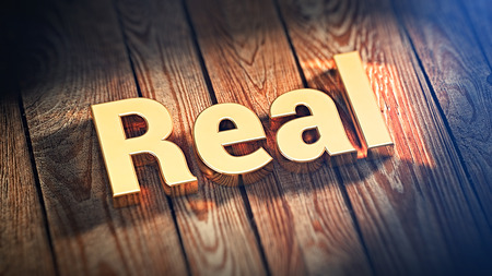 The word Real is lined with gold letters on wooden planks. 3D illustration image