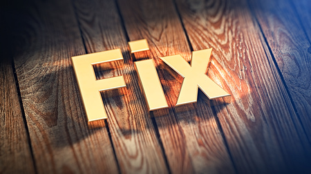 immobilize: The word Fix is lined with gold letters on wooden planks. 3D illustration image