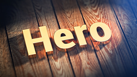 The word Hero is lined with gold letters on wooden planks. 3D illustration image