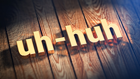 The word uh-huh is lined with gold letters on wooden planks. 3D illustration image Stock Photo