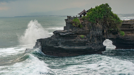 Sacred Tanah Lot temple in bad weather condition, Bali, Indonesia