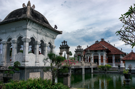 The stone bridge leading to the Taman Ujung Royal Palace, Bali, Indonesia Фото со стока
