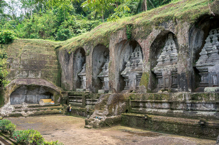 Ancient tombs carved in rock in funeral complex Gunung Kawi near Ubud, Bali, Indonesia Stock Photo