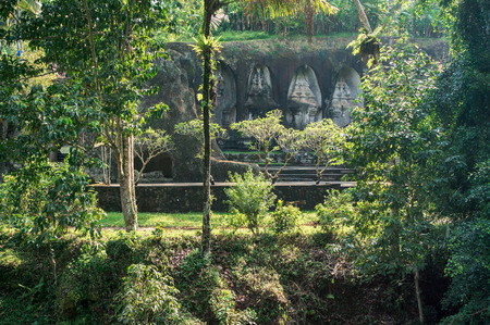 The view of Gunung Kawi caves from tropical forest. Gunung Kawi is a funeral complex with rock-cut tombs near Ubud, Bali, Indonesia