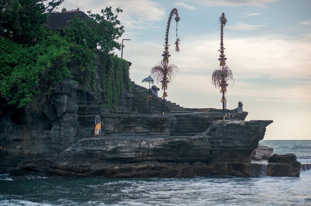 Traditional balinese penjors decorated the entrance to the sacred Tanah Lot temple, Bali, Indonesia