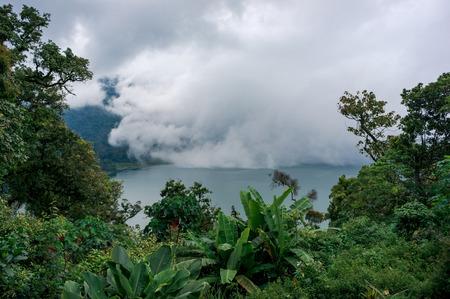 White mist is covering the twin lakes Buyan and Tamblingan on Bali, Indonesia Фото со стока